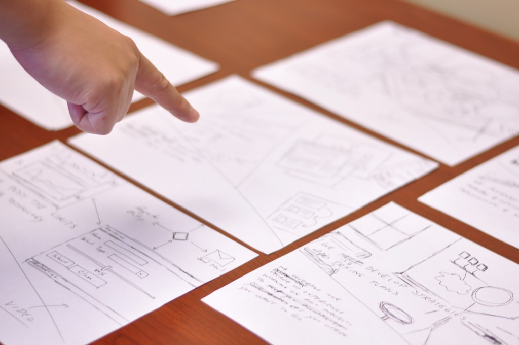 Our designer explaining the sketches and wireframes of our new Applied Imagination website redesign.